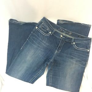 Seven7 Luxe are light distressed jeans